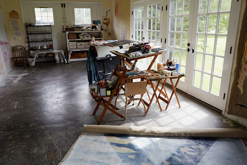 Her studio in the converted livery overlooks the property.