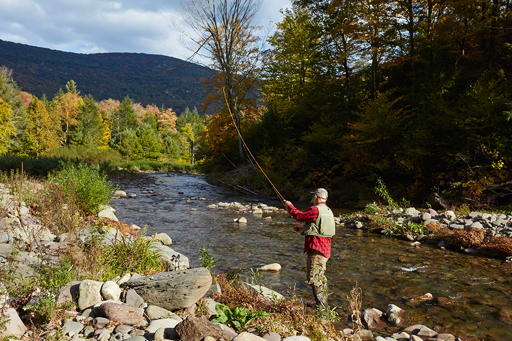 Staying for dinner? In the stream running through the property, Holz catches trout with his Pezon et Michel bamboo rod.