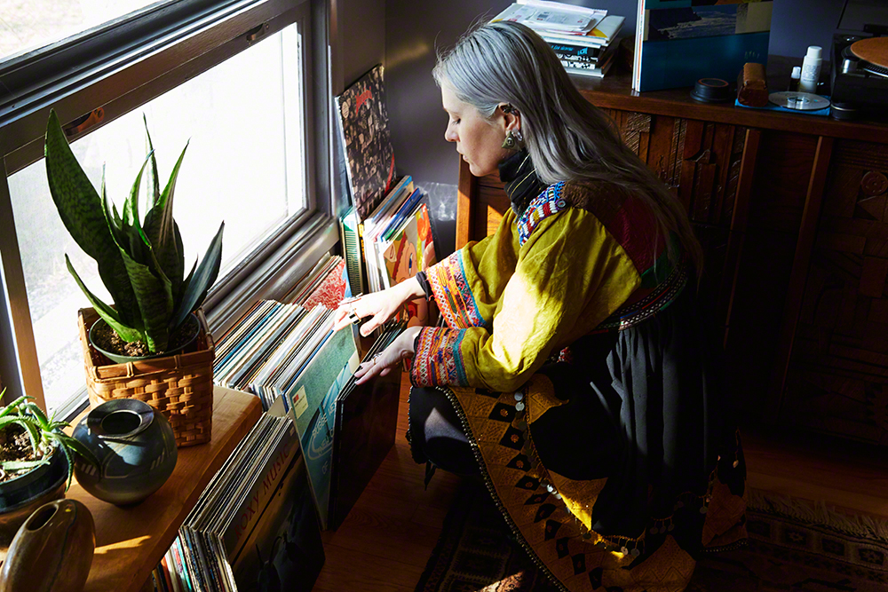 Browsing thru a small part of the couple's 7000+ album collection featuring 'Experimental, Jazz, Cosmic, World...' wearing one of her unique Afghan 'Kuchi' dresses.