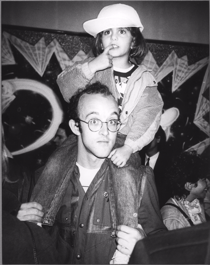 Nina Clemente, 4 years old with Keith Haring, NYC 1985. Photo: © Andy Warhol. Courtesy of Nina Clemente.