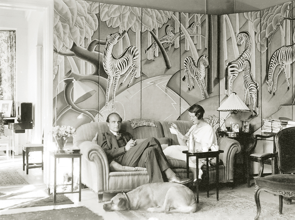 Margaret and her husband, Knut Richard Thyberg, with Antoinette, their Bullmastiff, sitting in front of an extraordinary eight-panel screen of zebras, painted by Olin in 1932. During this time the Thybergs were living in Copenhagen. Margaret had married the Swedish diplomat in 1925 at Foxhollow Farm.
