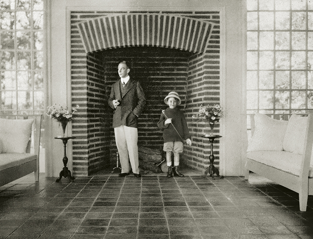 Harrie T. Lindeberg standing with Olin Dows in the large brick loggia fireplace in 1910.