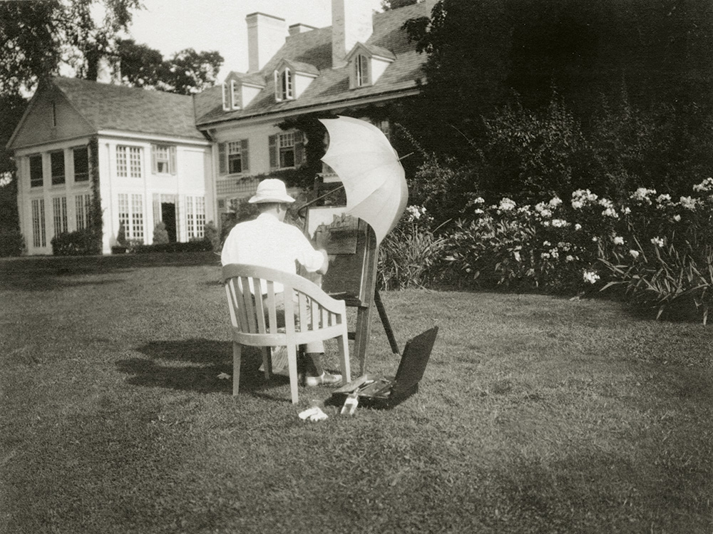 Olin Dows painting on the back lawn of Foxhollow Farm in 1918.