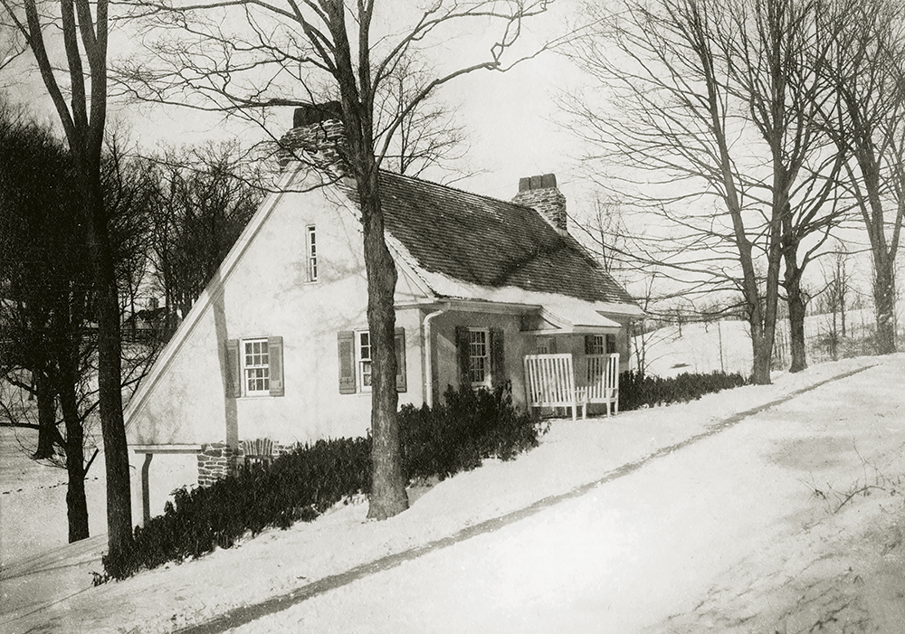The Gate Lodge, winter 1912. Designed in the estate's Colonial Revival style in stone and stucco by Lindeberg in 1910, the lodge was sited at the rear entrance of the Foxhollow Farm property at Vanderburgh Cove, where Landsman's Kill meets the Hudson River. In the late 1920s, the American author Thomas Wolfe, a Harvard classmate of Olin Dows, spent several summers at the lodge writing his classic novel, Look Homeward, Angel.
