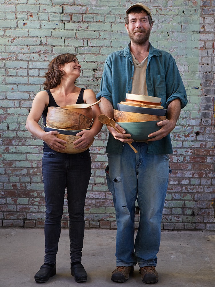 Kyra & Matty Hart / Aubry with their hands full of their wooden bowls and spoons! Instagram @aubrywoodworks