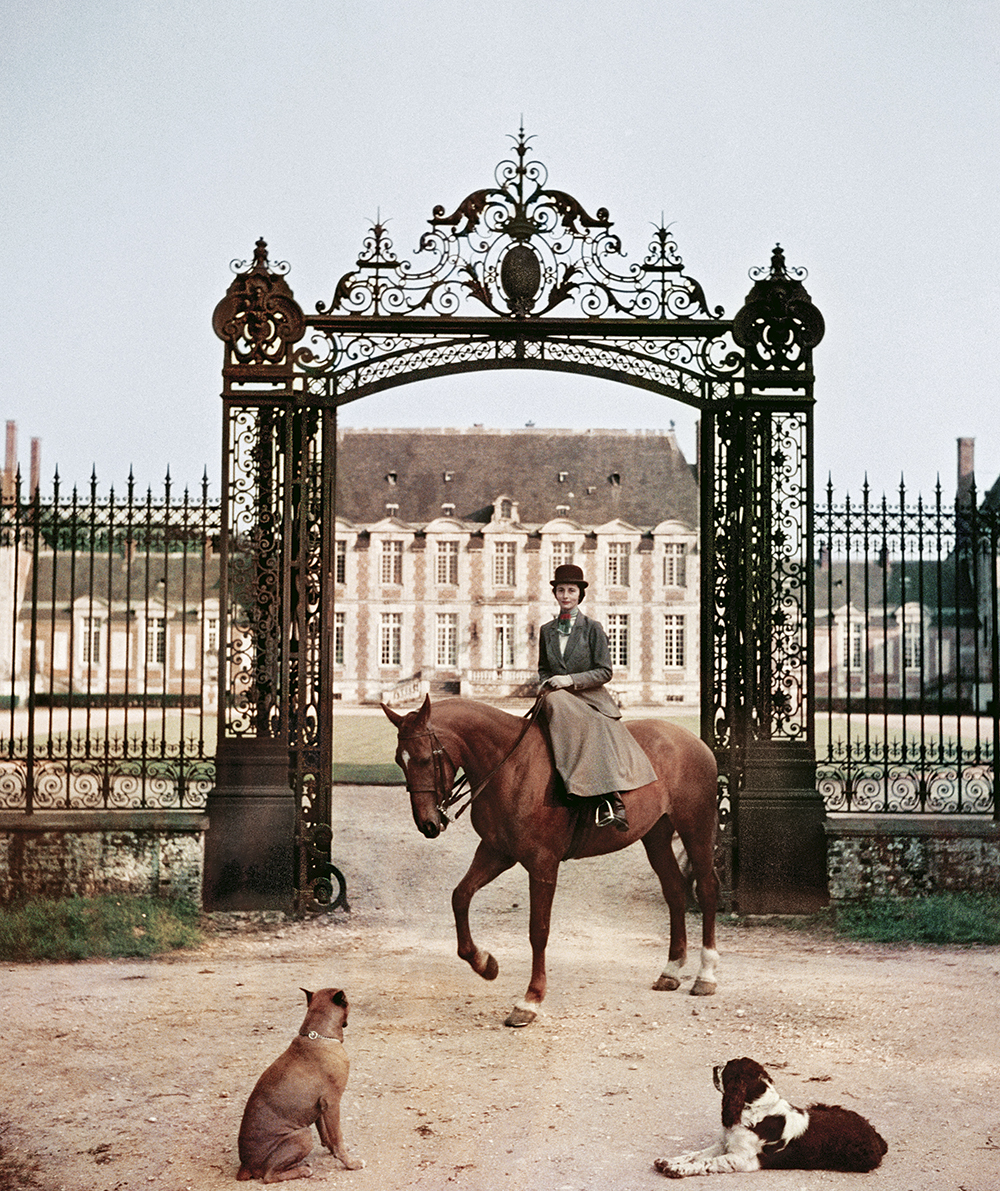 Laure de La Haye-Jousselin at the gates to her château in Normandy, 1957.  ©Slim Aarons/ Getty Images.