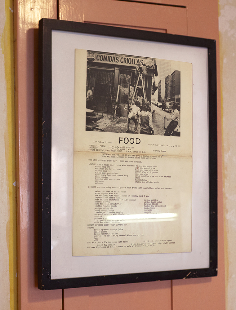 Displayed on the wall is an original menu from Carol Goodden, Tina Girouard, and Gordon Matta-Clark's Artist restaurant, FOOD.