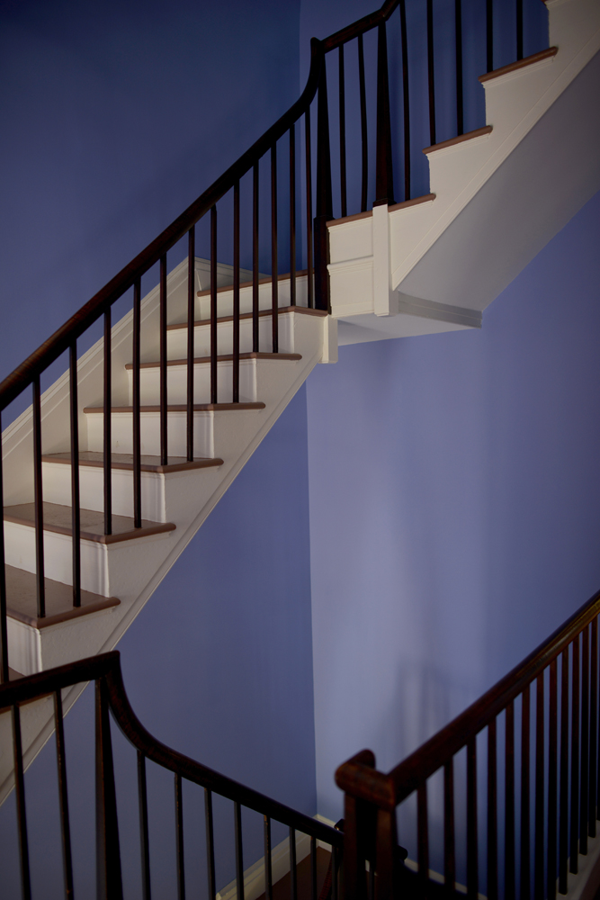 Stairs in the periwinkle foyer. Color consultation by historic interiors expert Jean Dunbar with historic paint specialist Matthew Mosca (who discovered Cole's decorative borders.)