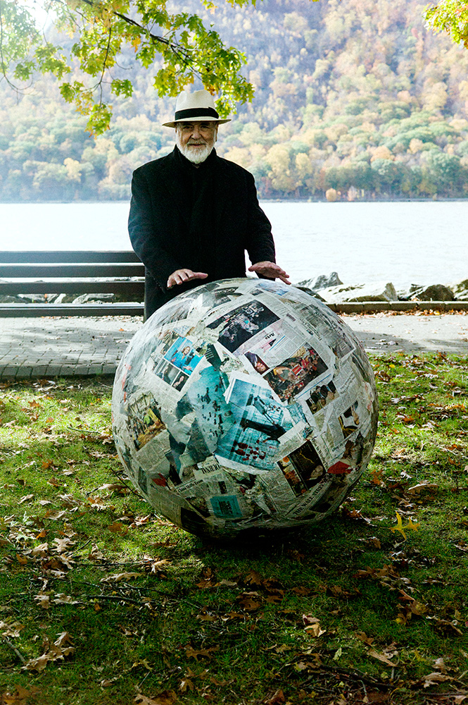 Pistoletto on the Hudson River waterfront at  Cold Spring  with his latest rendition of   Newspaper Sphere  ( Sfere di Giornali ) . The original sphere was created in '66 and rolled onto the streets of Turin, Italy in '67, which became the historical performance piece  Walking Sculpture  ( Scultura da Passeggio ).