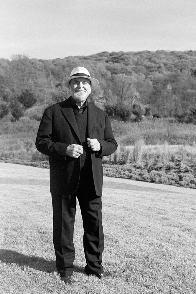 The artist in the beautiful landscape of Magazzino, where several of his works are shown. Pistoletto is one of the most recognized contributors to the Arte Povera movement.