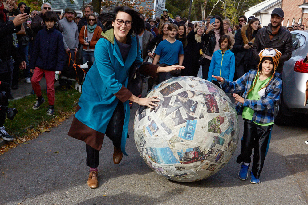 Artist Melissa McGill runs with Pistoletto's Newspaper Sphere down Main Street of Cold Spring, NY. This particular rendition of the sphere is created from the pages of the three local newspapers that initially announced the creation of Magazzino Italian Art, the new warehouse art space devoted to Post-War and Contemporary Italian art in Philipstown, NY. Ph: Kate Orne. Learn more about Magazzino and its founders Nancy Olnick and Giorgio Spanu in Issue 5 of Upstate Diary.