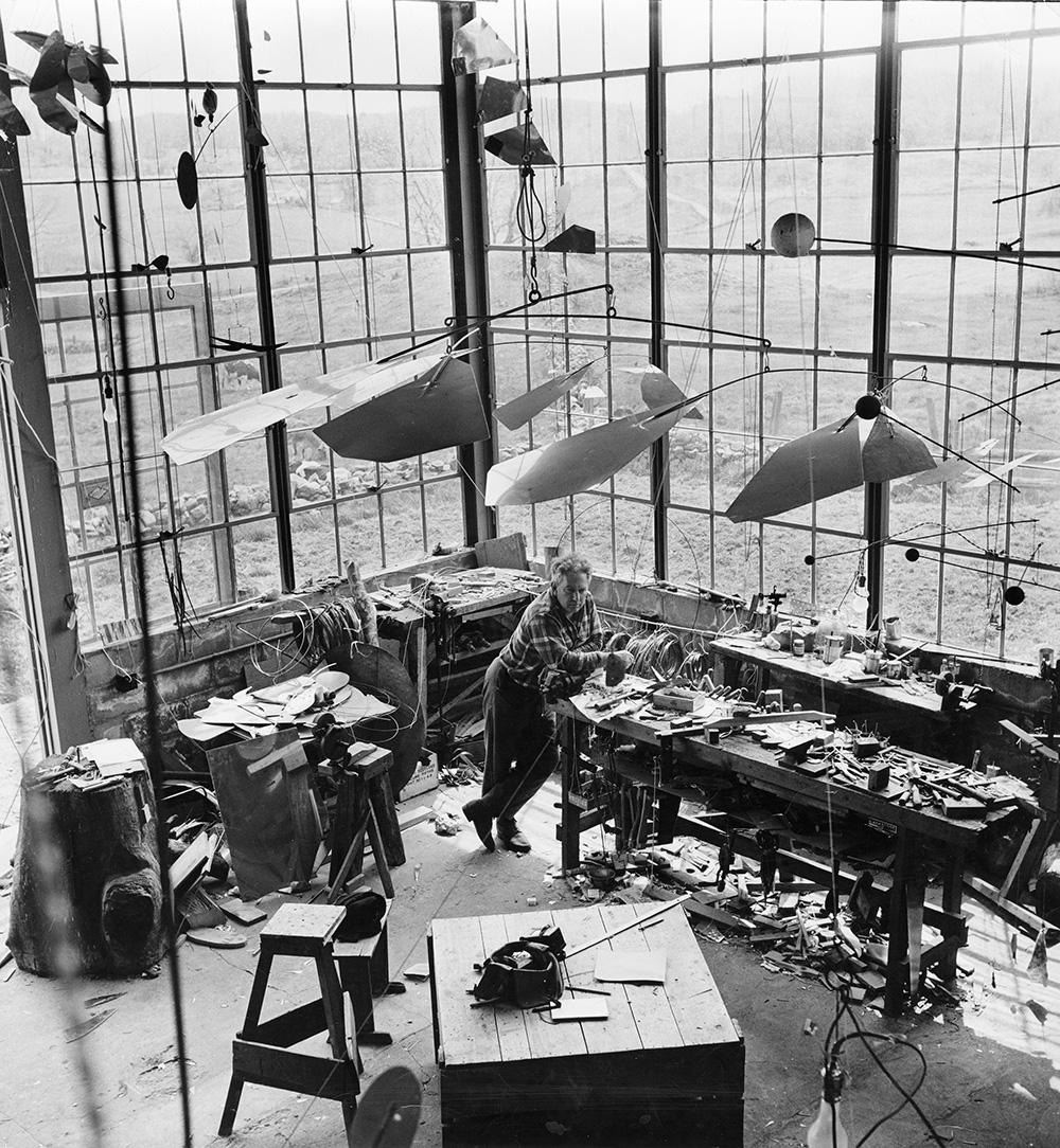 Calder with  Mobile  (1941) in his Roxbury studio, 1941.