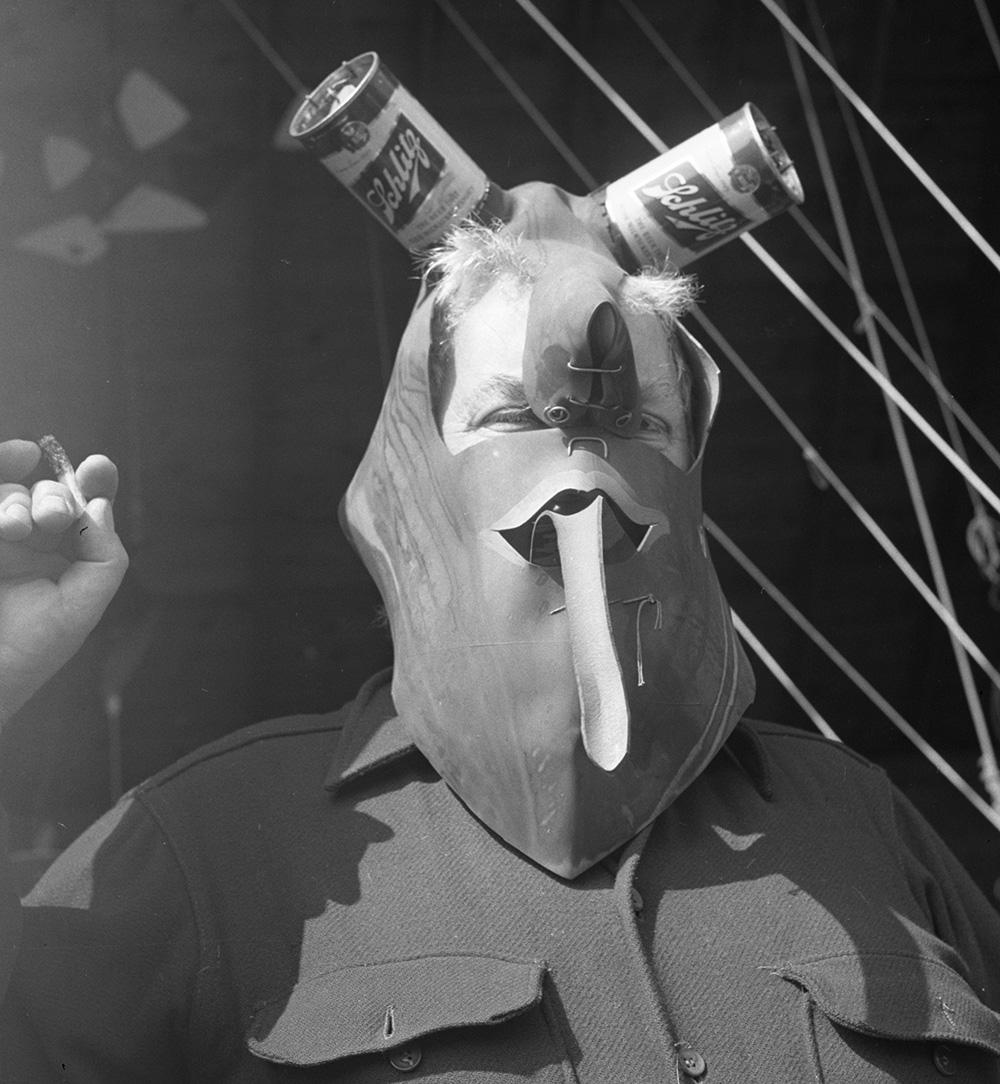 Calder wearing  Mask  (c.1945), Roxbury studio, 1950.