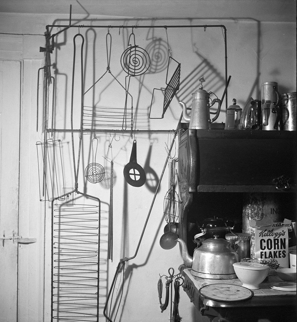 Rack with grills and utensils (c. 1935-40), Roxbury house kitchen, 1950.