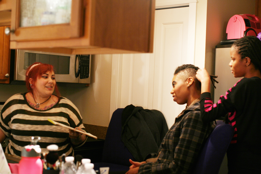 Talking shop in the kitchen-- makeup artist Cass Sarutos, model Briona Allen, and hair stylist Amani Carithers.