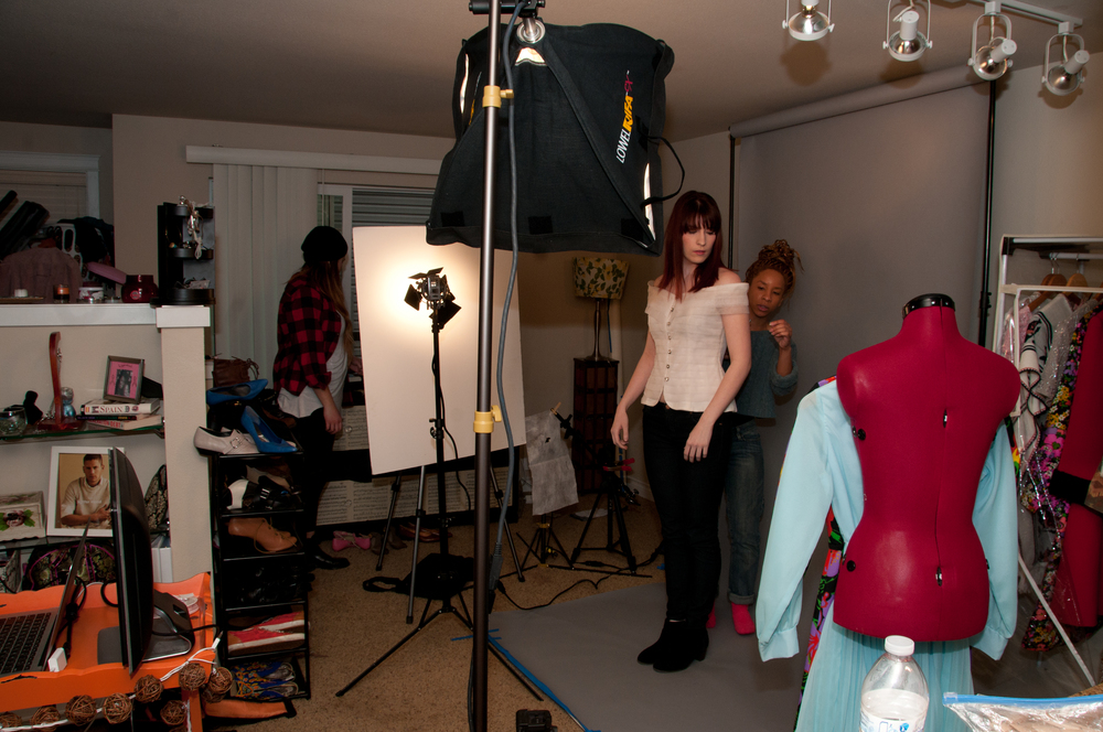 Angela fixes the wardrobe of model Ellie while Jerrie searches for the perfect accessory.