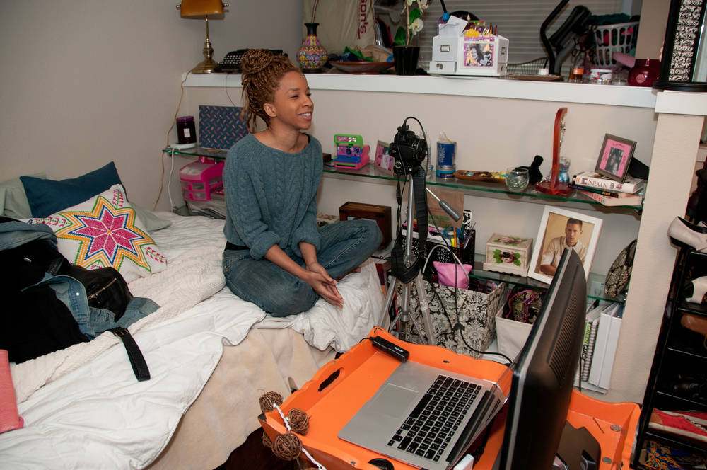 Afrobeatnik founder and creative director Angela Moorer prepares to shoot... from bed.