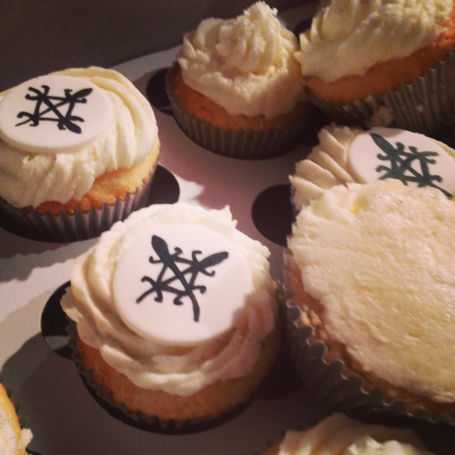 "Our Cupcakes were custom made by Harriet's House of Cakes and feature the West African Adinkra symbol used in Afrobeatnik's logo meaning ""Unity in Diversity"""