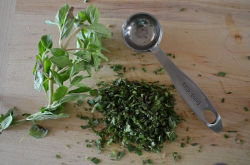 Finely chop some oregano; this is what fresh oregano looks like.  Pound these herbs together with a mortar and pestle if ya got one.