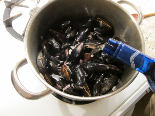 Keep pouring the wine to cover the mussels. It'll boil down.