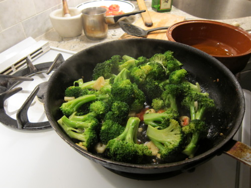 Throw the broccoli into the same pan you sauteed the garlic and tomatoes in.