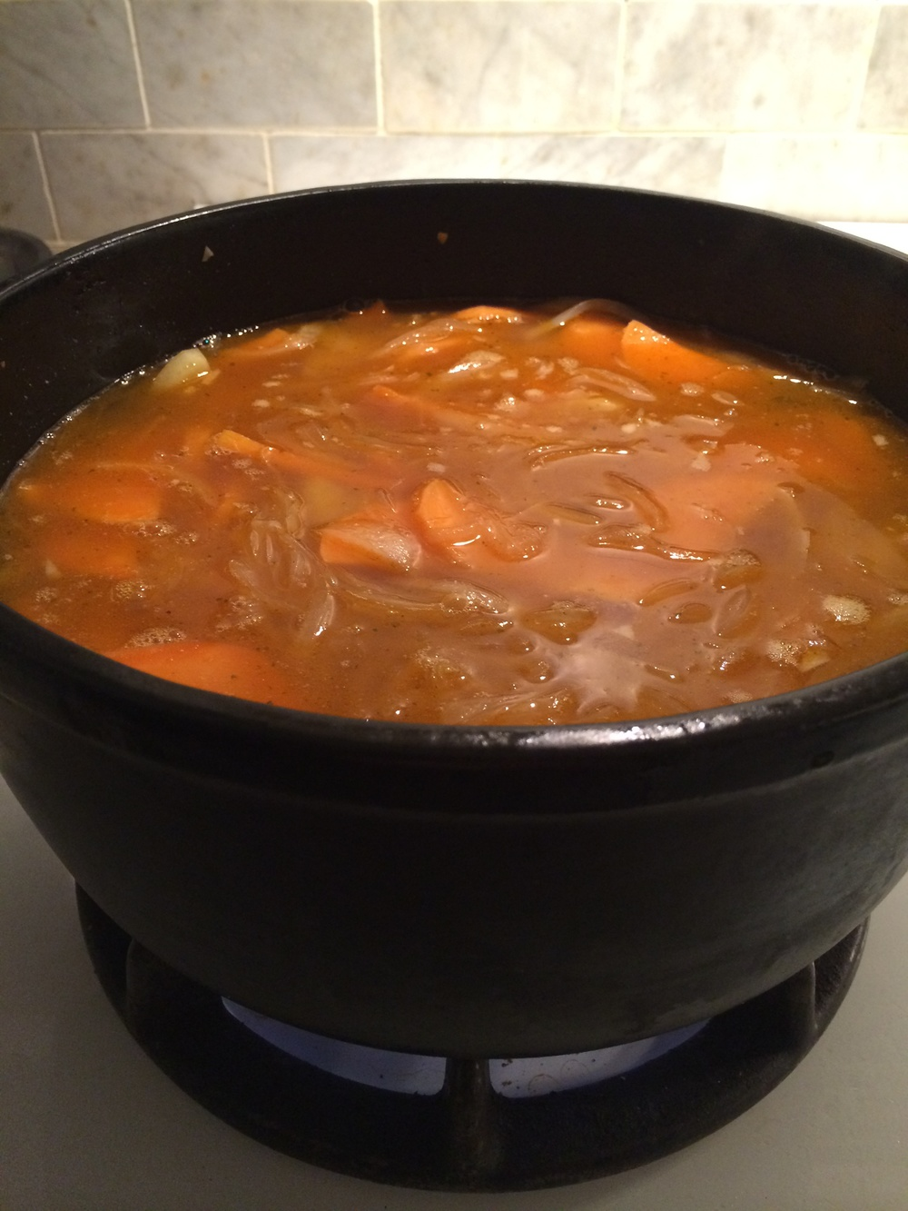 Add 6 cups stock and bring it to a boil. Then let it simmer until potatoes are even softer. Say 20 minutes.