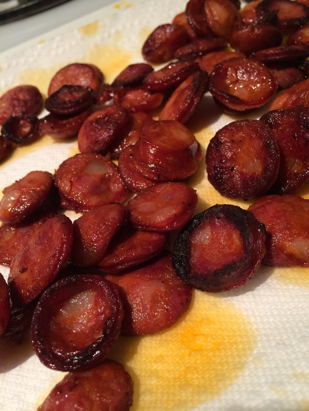With a slotted spoon, remove the chorizo from the pot and transfer to paper towels. Leave the chorizo oil BE.