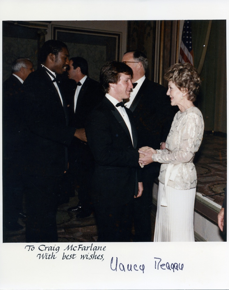 Receiving an award from First Lady, Nancy Reagan.