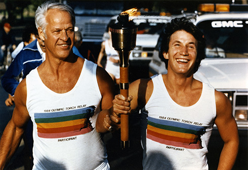 Gordie Howe and Craig carrying the Olympic torch through Washington, D.C. 1984