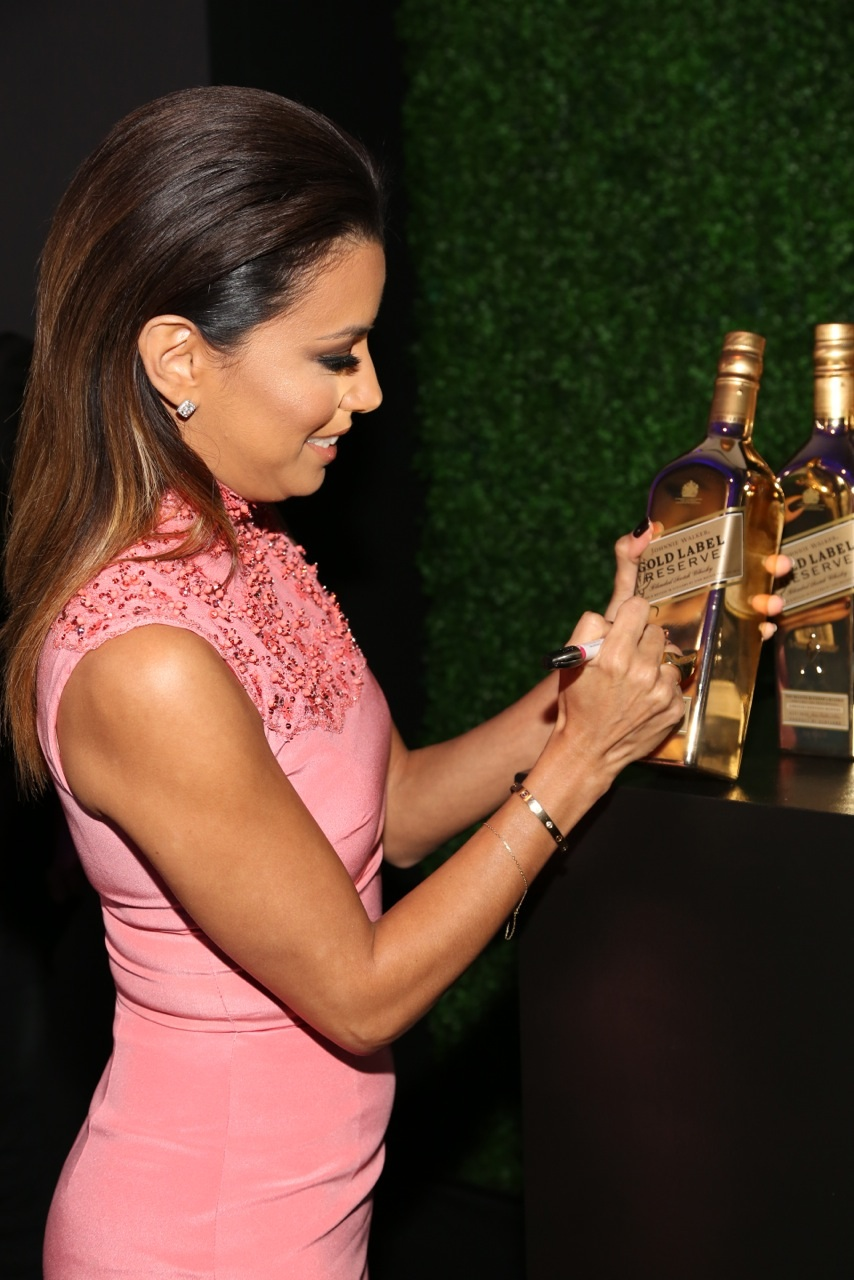 Eva Longoria signs Gold for Good with Johnnie Walker Gold Label Reserve at the unite4good and Variety unite4humanity event at Sony Pictures Studios on Thursday February 27 2014 in Culver City.jpg