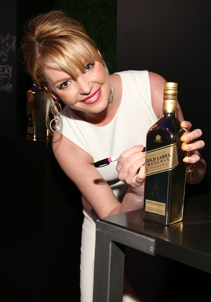 Katherine Heigl signs Gold for Good with Johnnie Walker Gold Label Reserve at the unite4good and Variety unite4humanity event at Sony Pictures Studios on Thursday February 27 2014 in Culver City.jpg