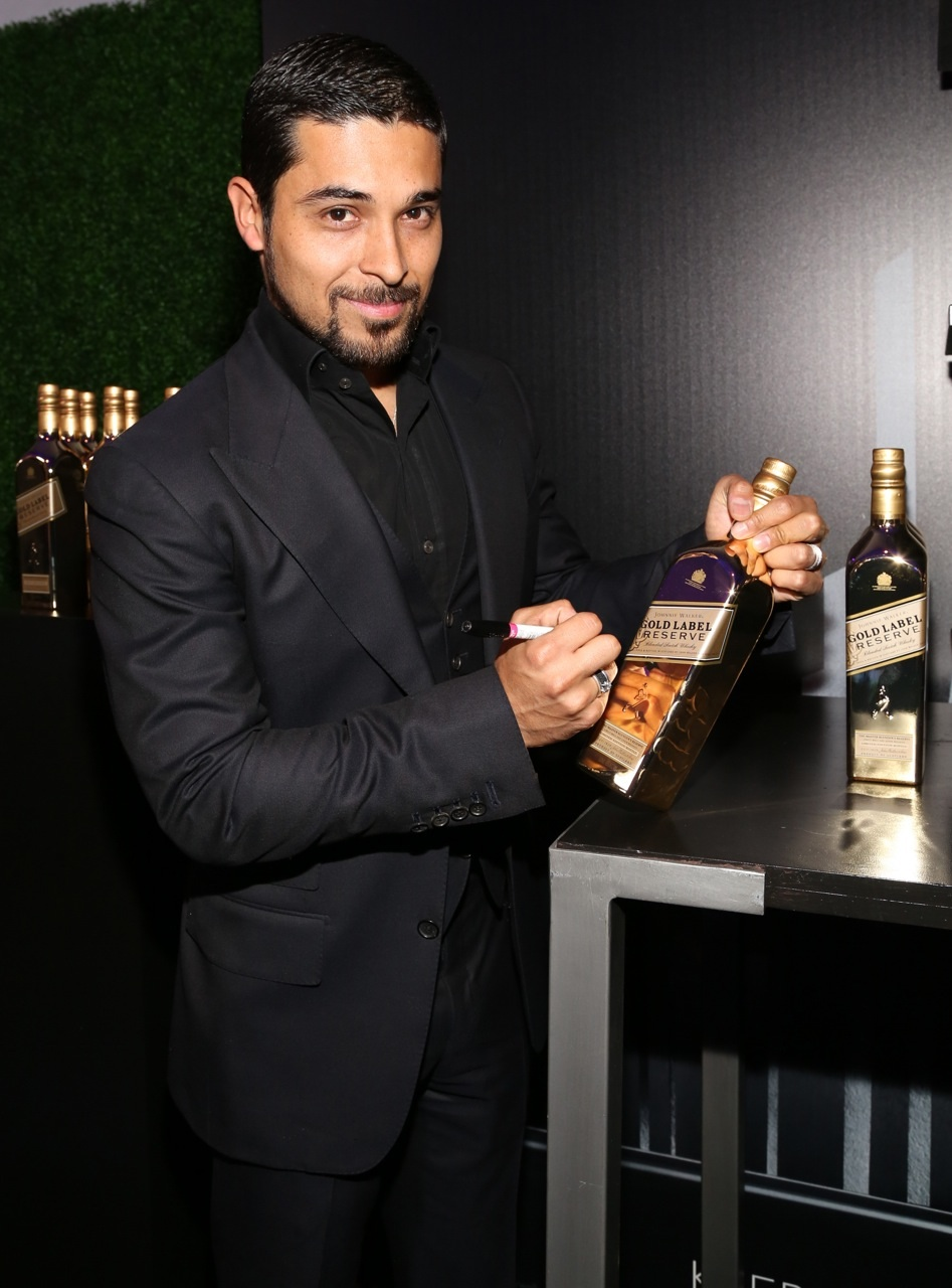 Wilmer Valderrama signs Gold for Good with Johnnie Walker Gold Label Reserve at the unite4good and Variety unite4humanity event at Sony Pictures Studios on Thursday February 27 2014 in Culver City.jpg