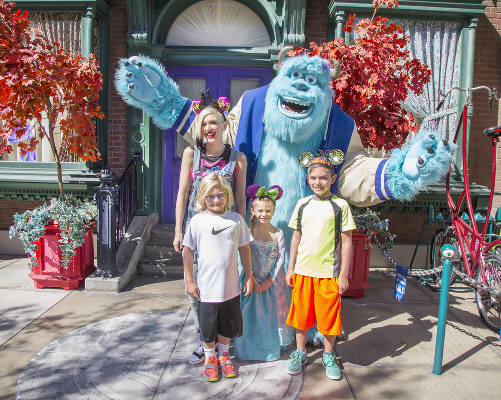 (October 6, 2014) Gwen Stefani and her sons, Kingston (right) and Zuma, and niece, Stella, meet Sulley from the Disney-Pixar films 'Monsters, Inc.' and 'Monsters University' at Disney California Adventure park in Anaheim, Calif., on Monday. The 'Halloween Time' celebration at the Disneyland Resort, which features special attractions, decor and entertainment, continues through October 31, 2014. (Paul Hiffmeyer/Disneyland Resort)