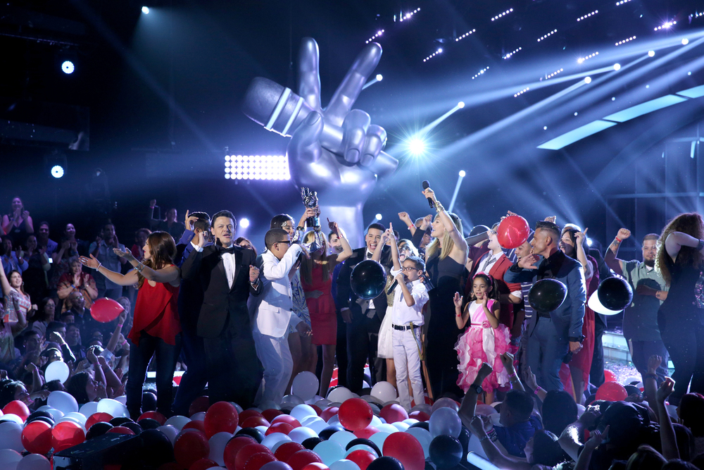 LA VOZ KIDS -- Season:3 -- Pictured: Jonael Santiago with family and friends, celebrating  -- (Photo by: Gregg Newton/Telemundo)