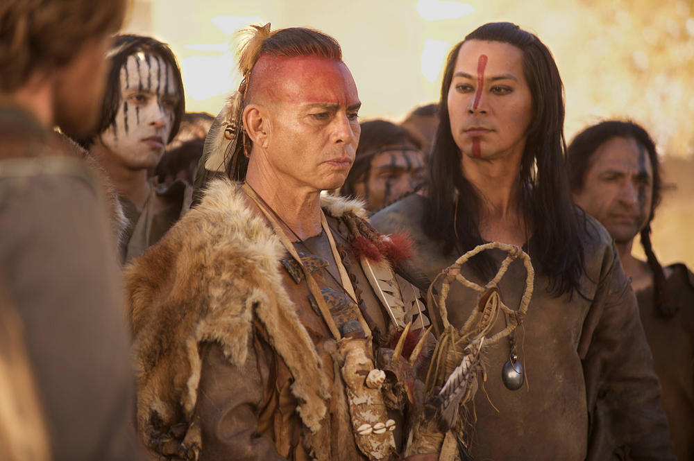 "Raoul Trujillo as Massasoit, center and Kalani Queypo as Squanto, right, in National Geographic Channel's two-night movie event ""Saints & Strangers,"" premiering Nov. 22-23, 9/8c.
