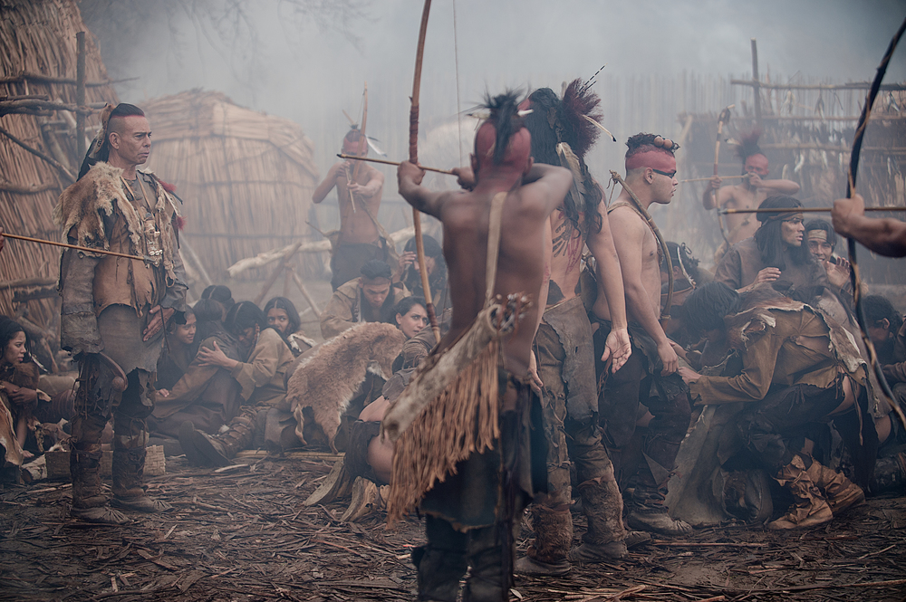 """Raoul Trujillo as Massasoit, left, in National Geographic Channel's two-night movie event """"Saints & Strangers,"""" premiering Nov. 22-23, 9/8c.  Massasoit is the sachem — or leader — of the Pokanoket tribe. A mysterious plague has decimated the Pokanoket population, leaving Massasoit uncertain of how to maintain his power among the Native Americans until he decides to forge an alliance with the Pilgrims. (photo credit:  National Geographic Channels/David Bloomer)"""