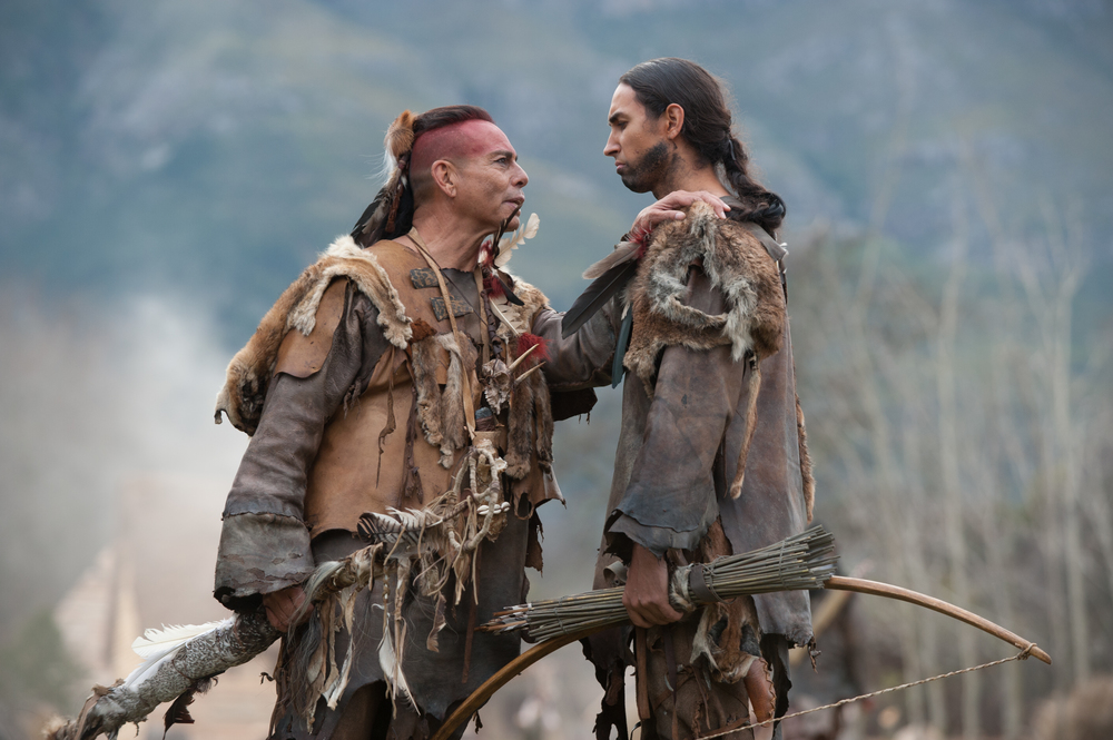 """Raoul Trujillo as Massasoit, left, and Tatanka Means as Hobbamock in National Geographic Channel's two-night movie event """"Saints & Strangers,"""" premiering Nov. 22-23, 9/8c.(photo credit:  National Geographic Channels/David Bloomer)"""