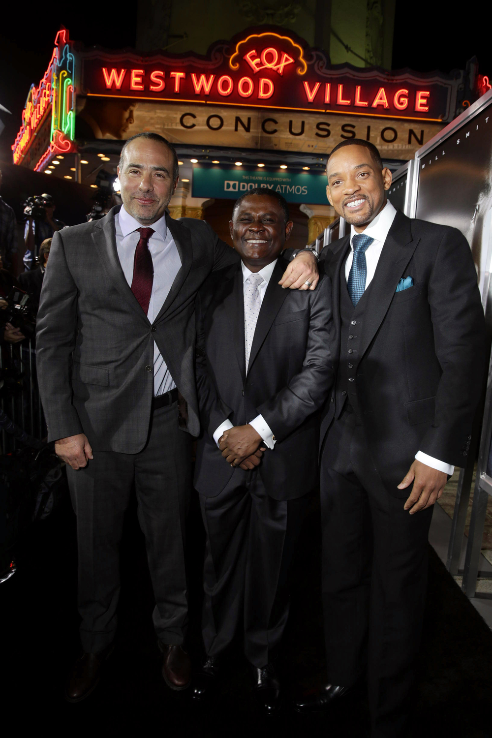 LOS ANGELES, CA- November 23, 2015. Director/Writer Peter Landesman, Dr. Bennet Omalu and Will Smith seen at Columbia Pictures' Special Screening of CONCUSSION at Regency Village Theatre.