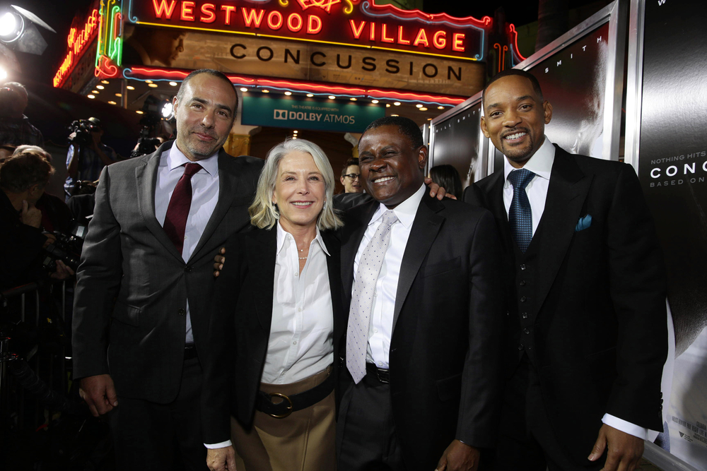 LOS ANGELES, CA- November 23, 2015. Director/Writer Peter Landesman, Producer Elizabeth Cantillon, Dr. Bennet Omalu and Will Smith seen at Columbia Pictures' Special Screening of CONCUSSION at Regency Village Theatre.