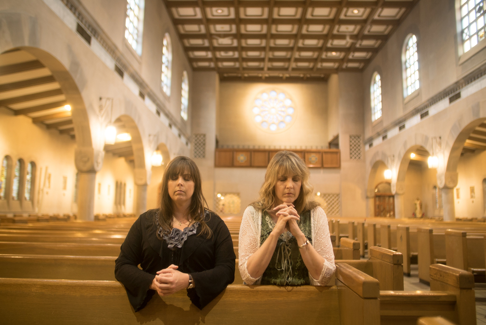 HARRISON, OHIO- Despite having their faith shaken by the traumatic experiences of their father, mother and sister at Caritas of Birmingham, Christa O'Neill and Caroline DeMarco remain devout Catholics. (Photo Credit: NG Studios/ Nick Midwig)