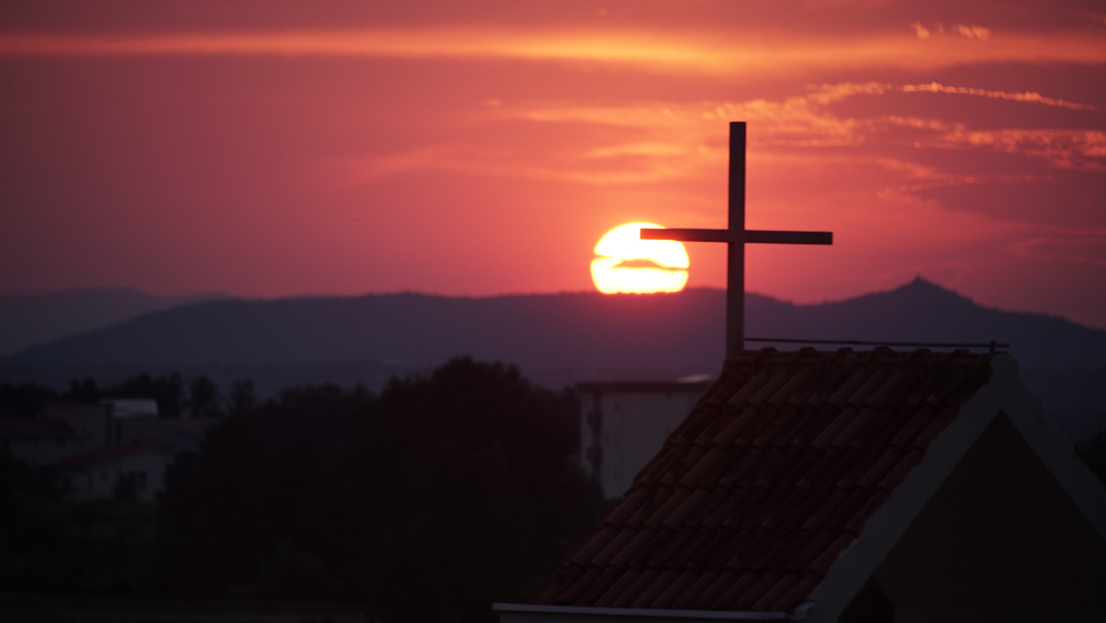 MEDJUGORIE, BOSNIA AND HERZEGOVINA- The sun sets over Medjugorje, a village in Bosnia and Herzegovina that attracts over a million religious tourists a year due to claims of recurring apparitions of the Virgin Mary experienced by six local visionaries. (Photo Credit: NG Studios/ Nick Midwig)