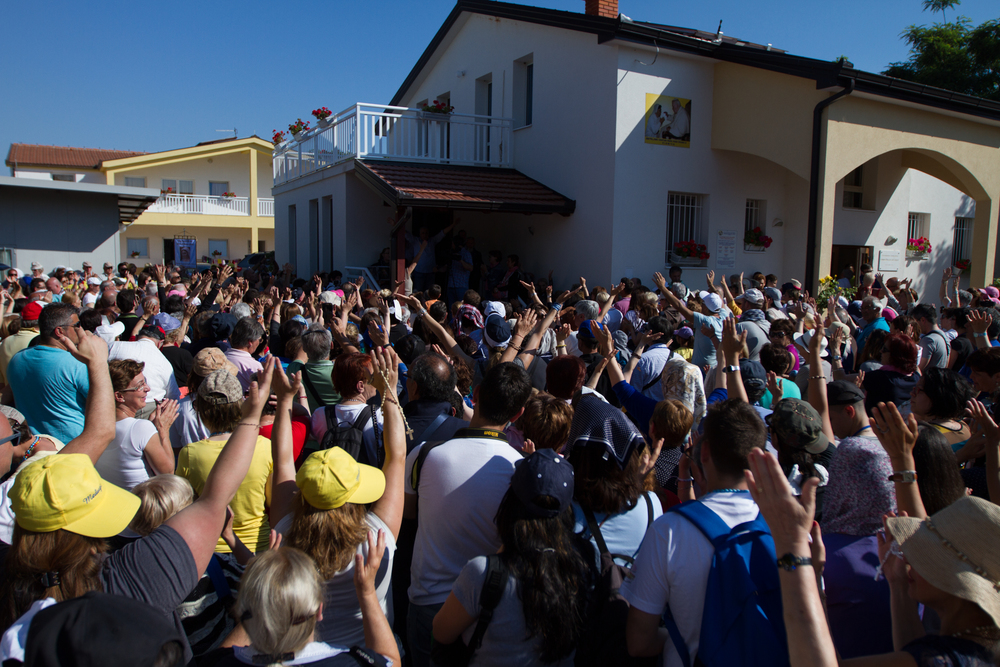 MEDJUGORIE, BOSNIA AND HERZEGOVINA- Hundreds of pilgrims in Medjugorje gather outside the home of Vicka Ivankovic, one of the six visionaries who has become known for miraculous healings. (Photo Credit: NG Studios/ Nick Midwig)