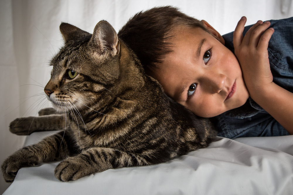 BAKERSFIELD, Calif. - Jeremy Triantafilo rests his head on Tara the cat, his unusual animal pal. These two grew up together, as brother and sister, so it makes sense that Tara, the protective older sister, was there for her little brother when he was in trouble. (National Geographic Channels/Roger Triantafilo)