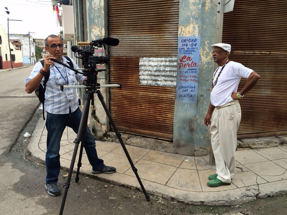 CUBA- The camera operator filmed b-roll of Julio Abreu Abreu, Babalawo, while he rested on a pole.