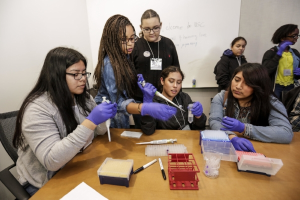 Students from Orthopaedic Hospital Medical Magnet High School practice using pipettes to handle small amounts of liquid at the Stem Cell Day of Discovery event held at the USC Health Sciences Campus in Los Angeles, CA. February 4th, 2017.  The event encourages students to learn more about STEM opportunities, including stem cell study and biotech, and helps demystify the fields and encourage student engagement. Photo by David Sprague