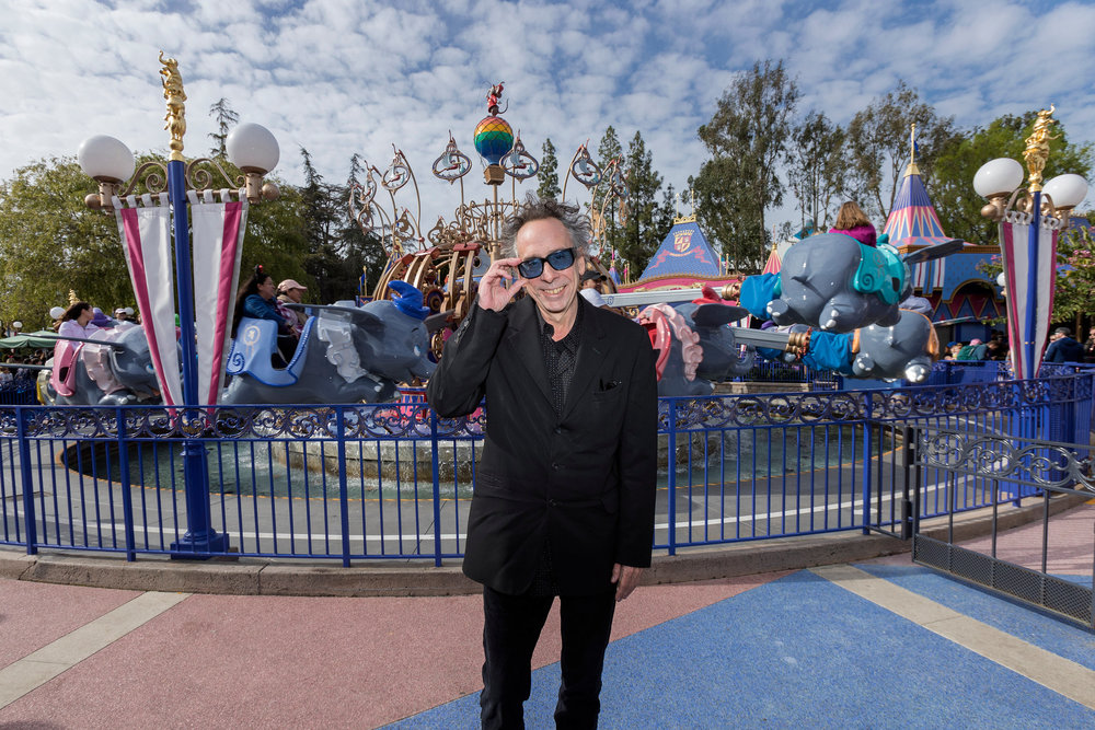 Director Tim Burton visits Dumbo the Flying Elephant at Disneyland Park in Anaheim, Calif., March 9, 2019, while celebrating the upcoming grand live-action adventure �Dumbo,� in theaters March 29. For a limited time, a sneak peek of the film can be seen in the Main Street Opera House at Disneyland Park.  (Joshua Sudock/Disneyland Resort)