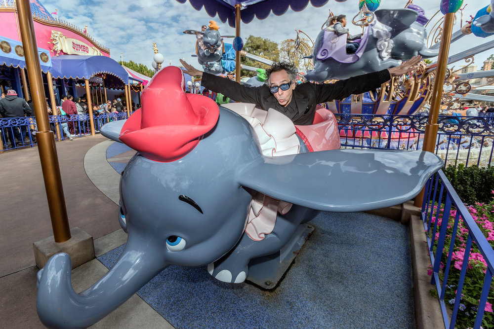 Director Tim Burton poses with Dumbo the Flying Elephant at Disneyland Park in Anaheim, Calif., March 9, 2019, to celebrate the upcoming grand live-action adventure �Dumbo,� in theaters March 29. For a limited time, a sneak peek of the film can be seen in the Main Street Opera House at Disneyland Park.  (Joshua Sudock/Disneyland Resort)