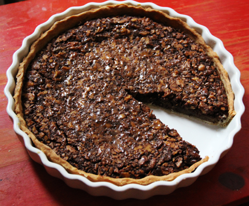 My Tennessee grandmother was famous for her delicious Southern pecan pie, and I've added chocolate and updated her recipe using less sugar. I also used walnuts, as pecans are difficult to find in Germany. However, both walnuts and pecans work well in this recipe and if you prefer a thicker filling, you can use a smaller pie pan too. Enjoy!