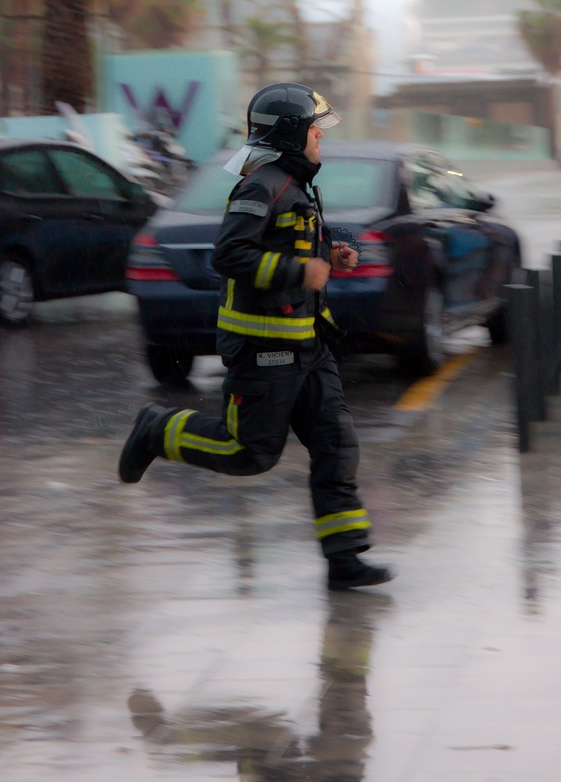 This photo was taken during the biggest storm to hit Barcelona in 50 years. This fireman was on his way to rescue one of his colleagues who had been washed out to sea.  Thankfully he was saved, but I wouldn't have captured this type of image if I had retreated back inside when the storm hit.
