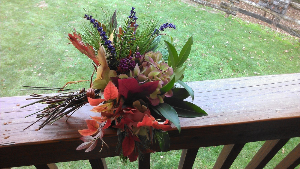 This last minute, all natural bouquet included an assortment of fall leaves, laurel leaves and pine, moss, pinecones, nandina berries, beauty berries, a single green hydrangea and a few sprigs of salvia.